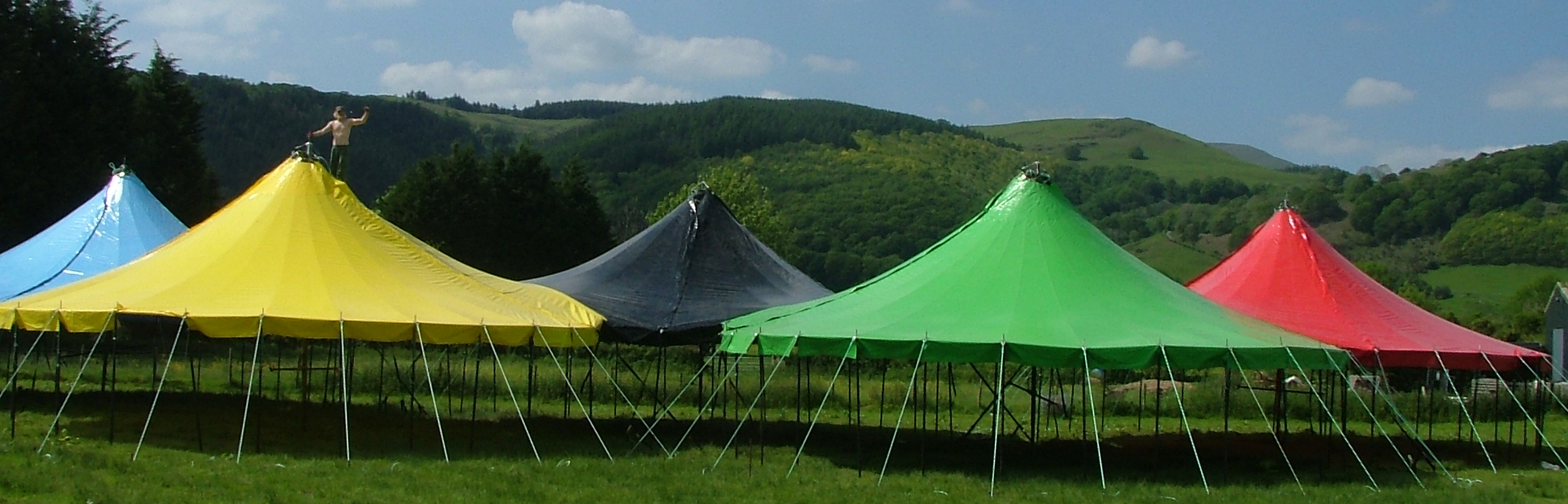 ... special saddle-shaped event marquees including the multi-ring Olympic tent the Glastonbury theatre stage circus tents and many more. & Roustabout Event u0026 Stage - Timber Intent Tensile Structures